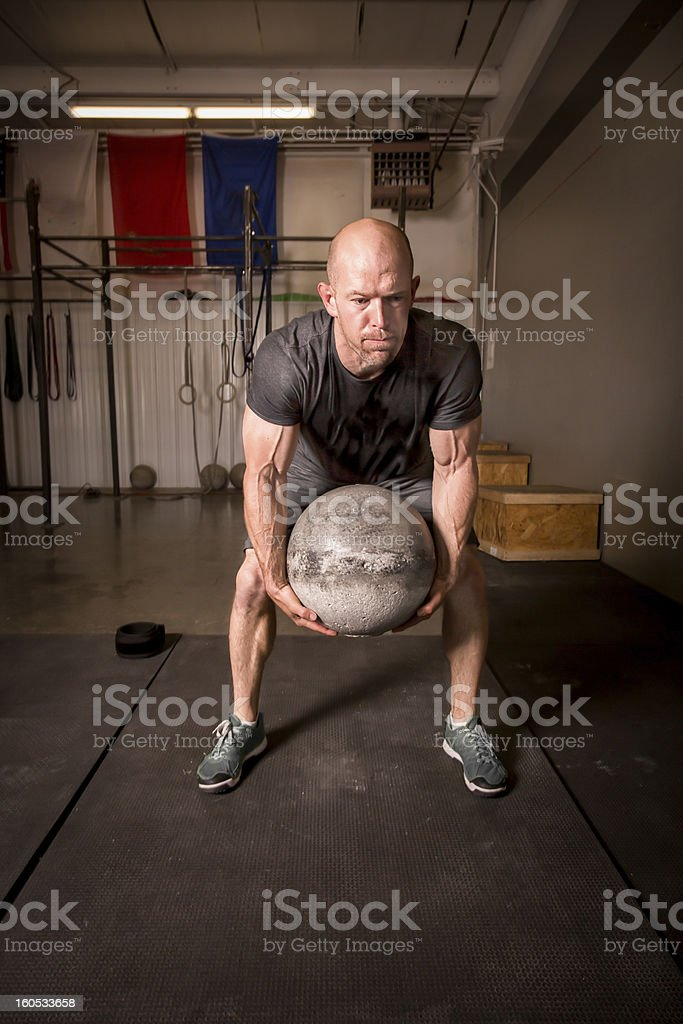 Man Lifting Atlas or Medicine Ball royalty-free stock photo