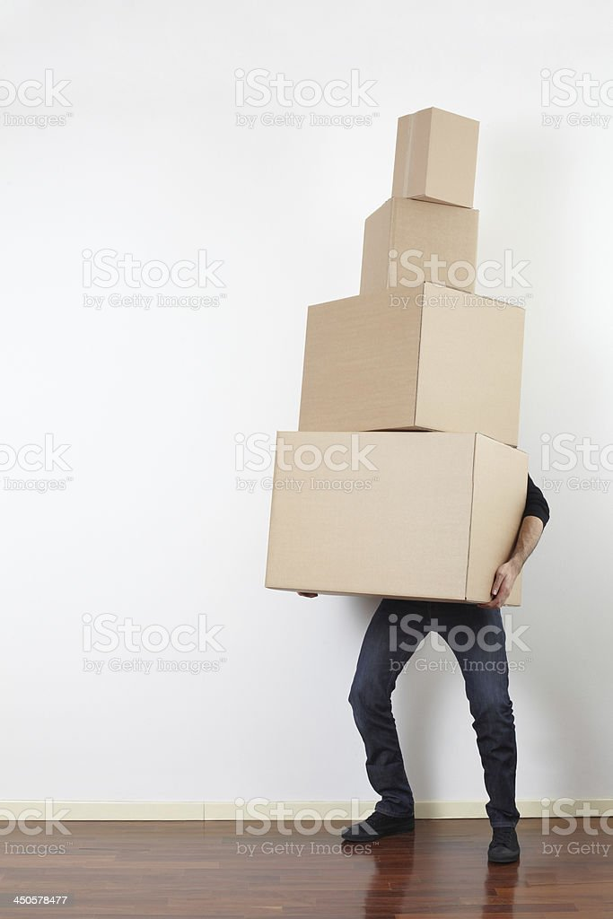 Man lifting cardboard boxes, moving day stock photo