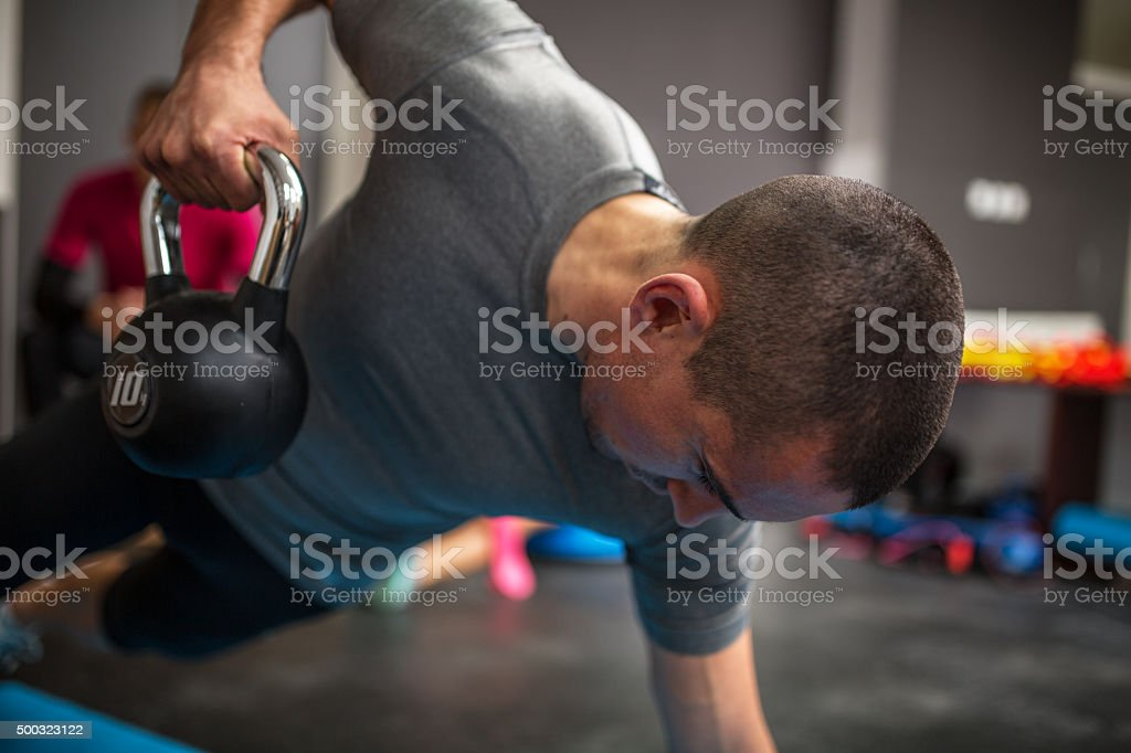 Man lifting dumbbell stock photo