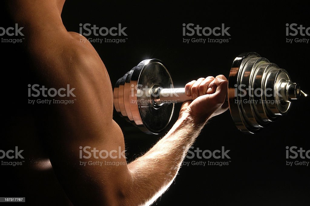 man lifting dumbbells royalty-free stock photo