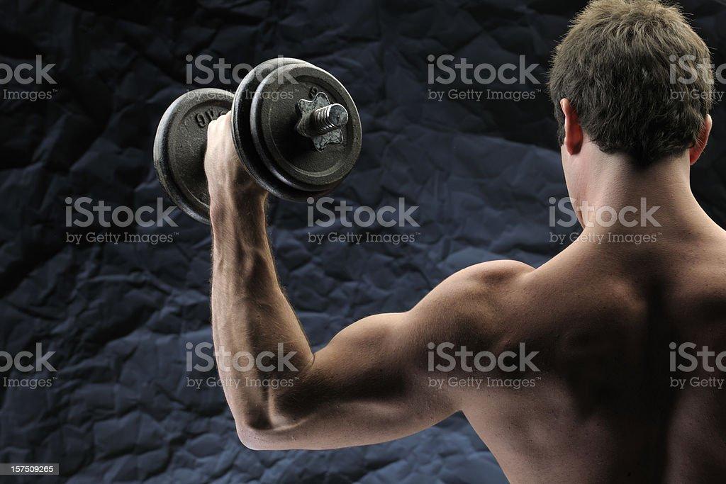 man lifting dumbbells royalty-free stock photo