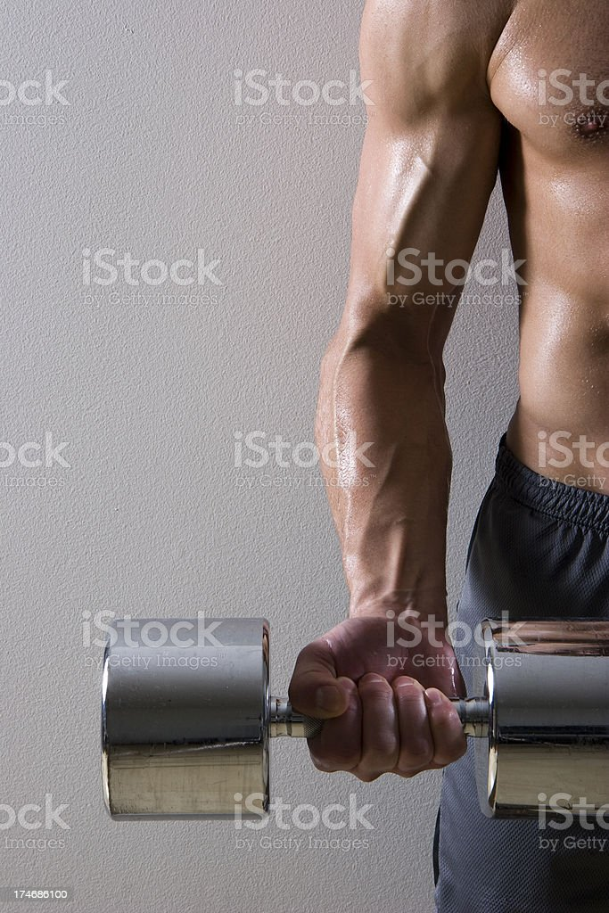 Man lifting dumbell stock photo