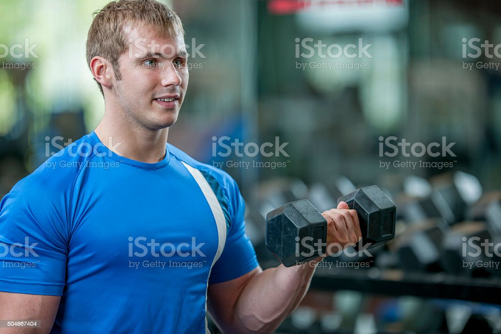 Man Lifting Free Weights stock photo