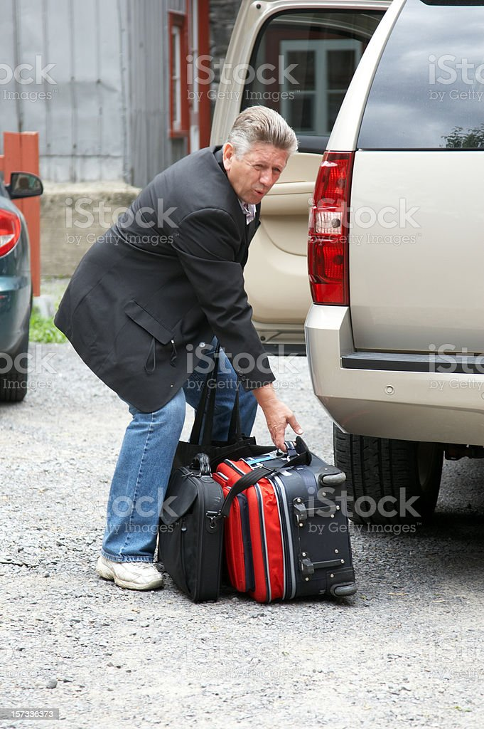 Man lifting heavy suitcase royalty-free stock photo