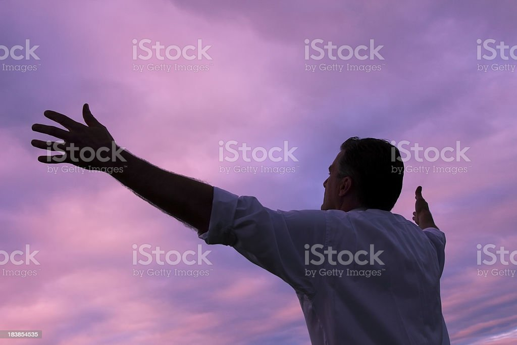 Man Lifting His Hands to the Sky royalty-free stock photo
