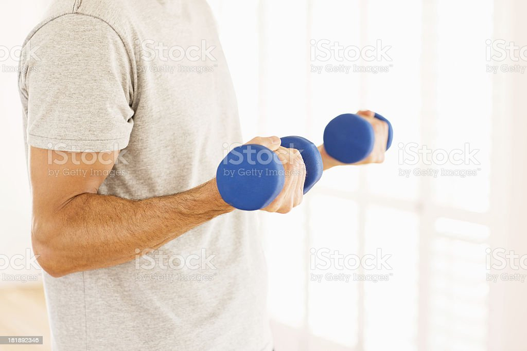 Man Lifting Weights At Gym royalty-free stock photo