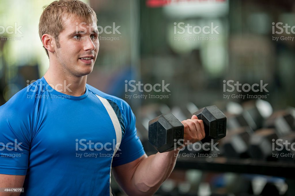 Man Lifting Weights at the Gym stock photo