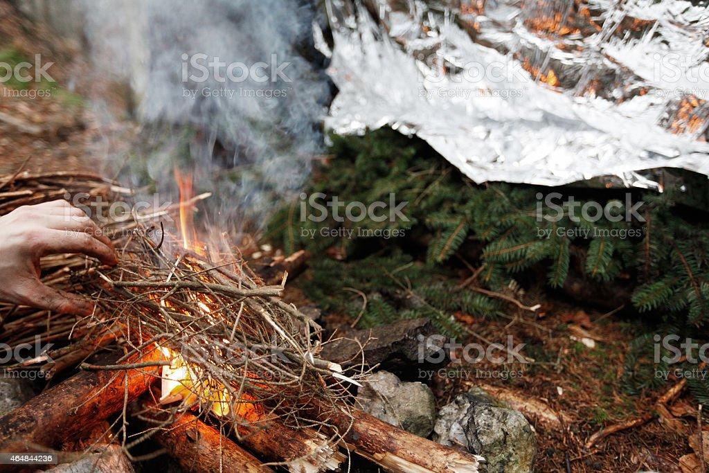 Man lighting an emergency fire stock photo