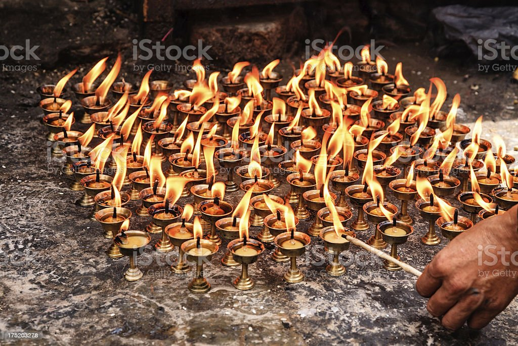 Man lighting diya, making a wish stock photo