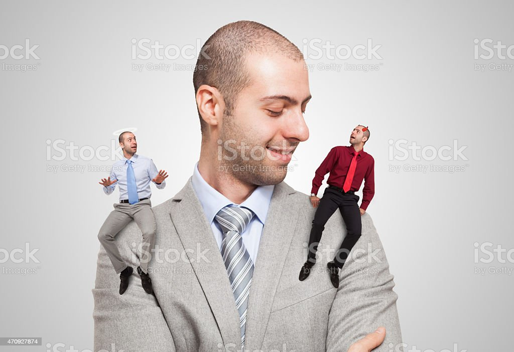 Man listening to the good and evil self stock photo