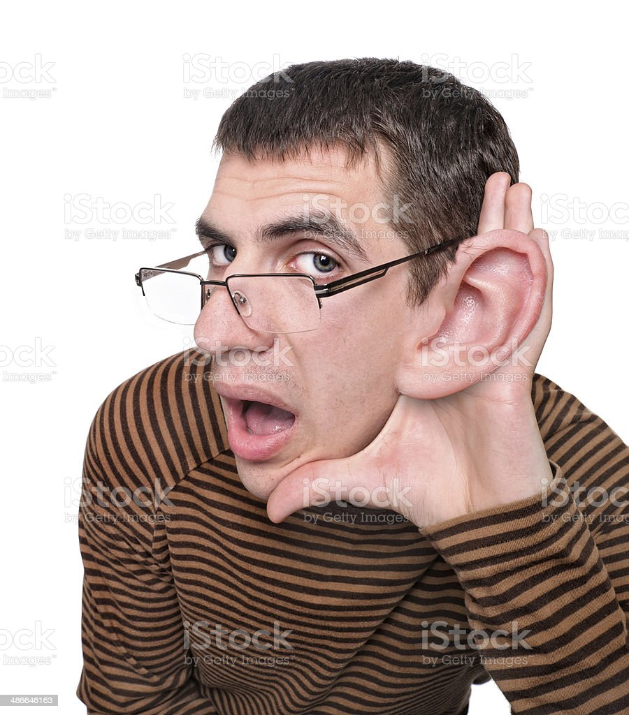 Man listening with big ear. stock photo