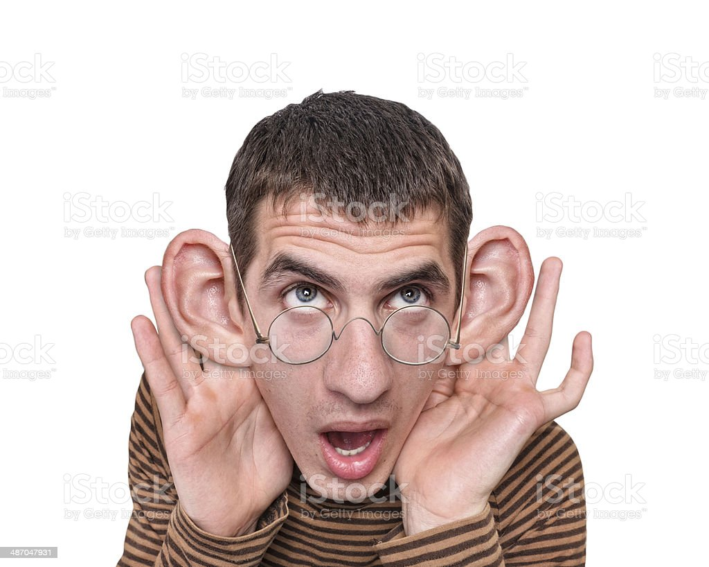 Man listening with big ears stock photo
