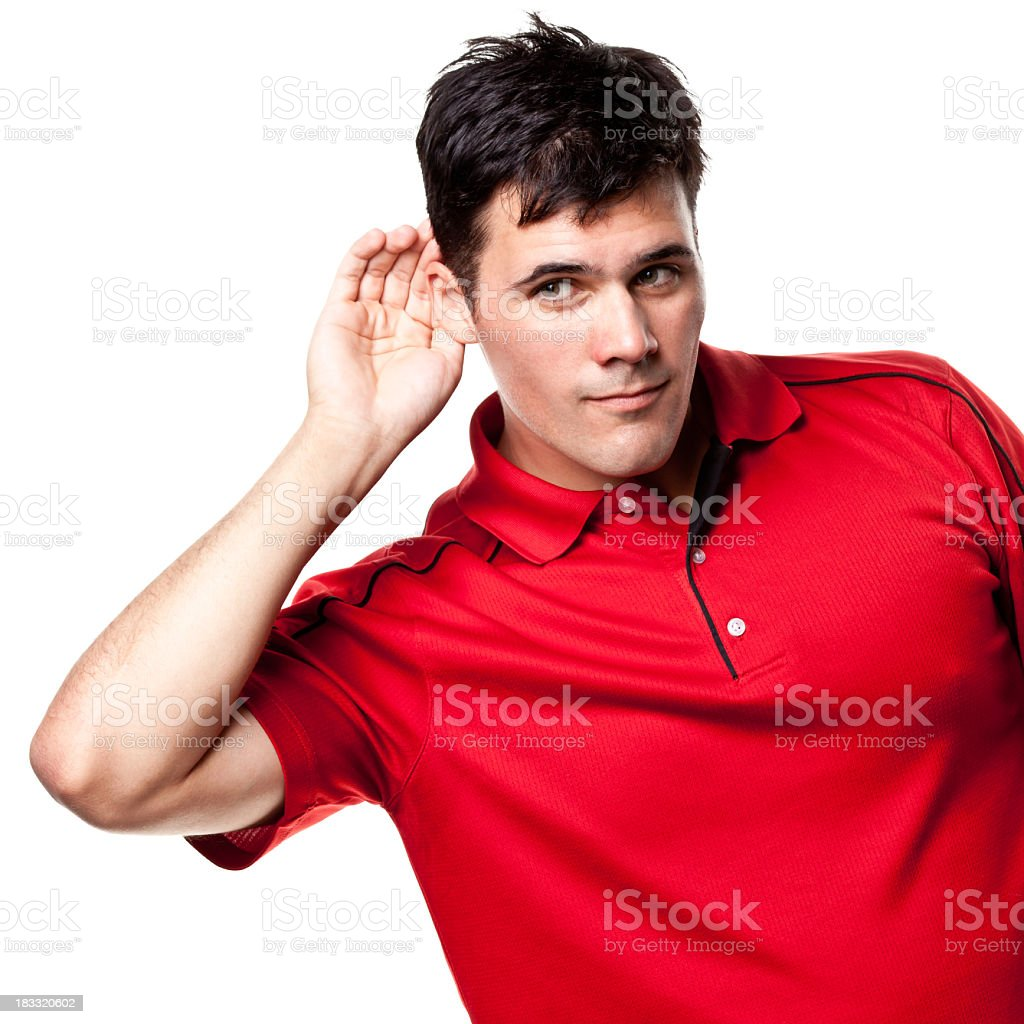 Man Listening With Hand Cupped Around Ear stock photo