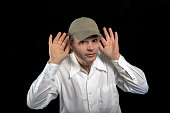 Man listening with his hands to his ears