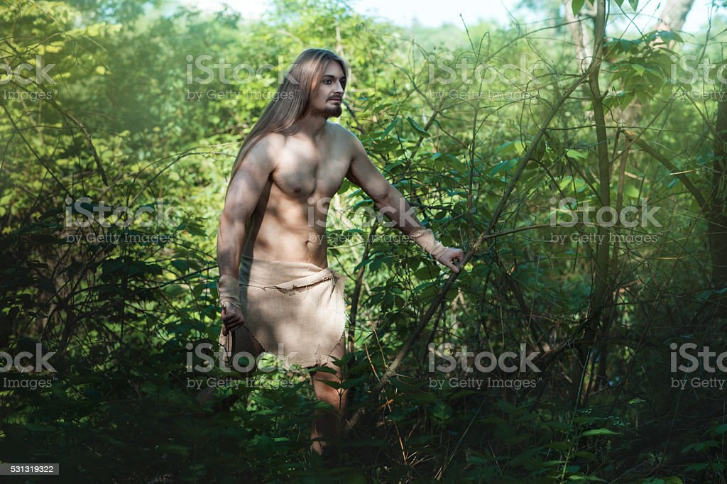 Man living in the woods like a wild. stock photo