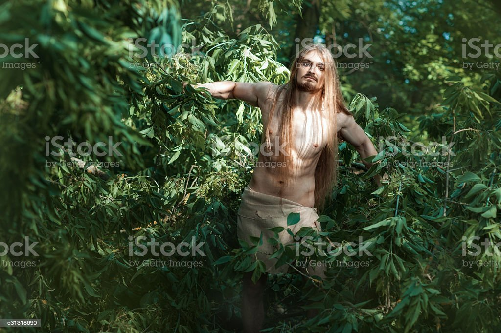 Man living in the woods. stock photo