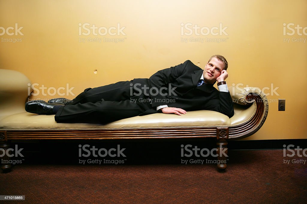 Man liying down on a couch royalty-free stock photo