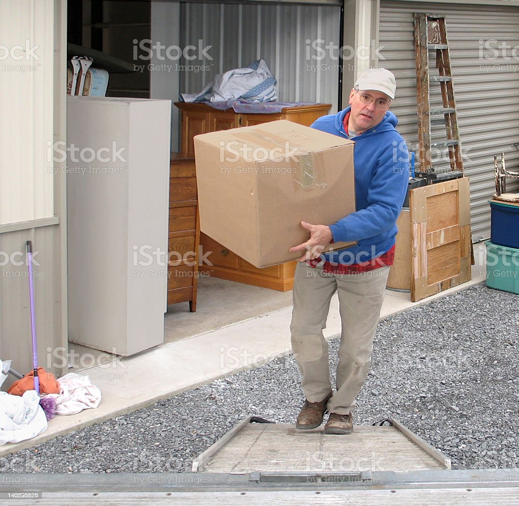 Man loads a moving van stock photo
