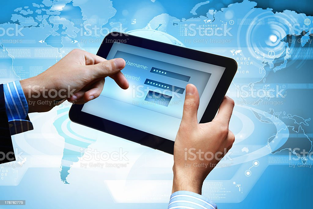 A man logging in an account on a tablet using his email royalty-free stock photo