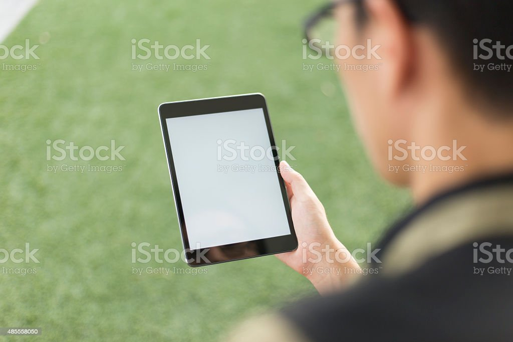Man Look a Blank Tablet stock photo
