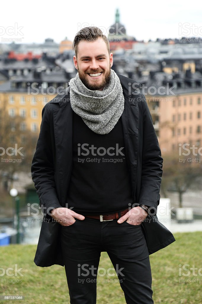Man looking around with cityscape stock photo
