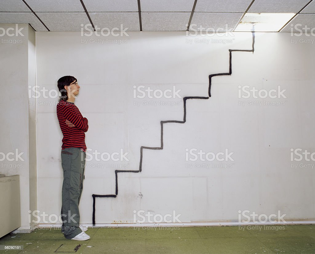 Man looking at a spray painted stairway royalty-free stock photo
