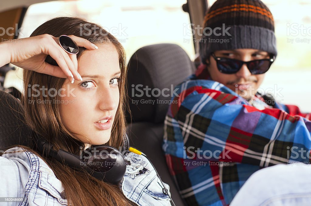 A man looking at a woman who seems annoyed stock photo