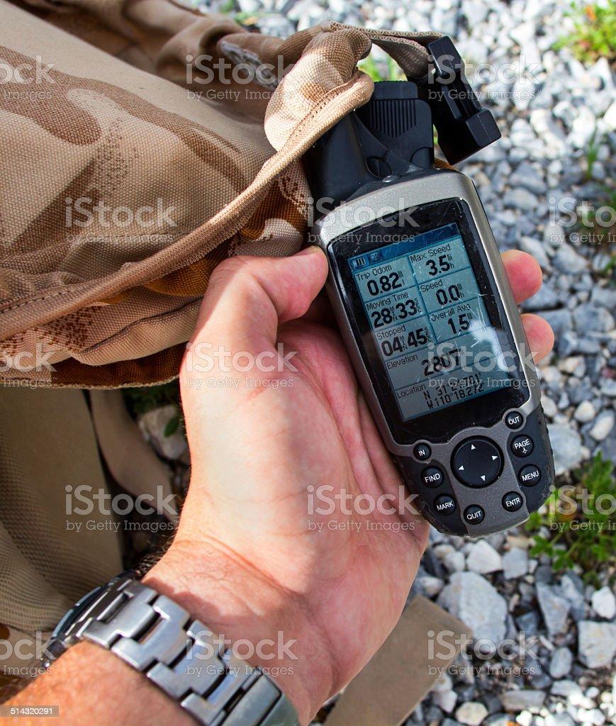 Man looking at altimeter stock photo