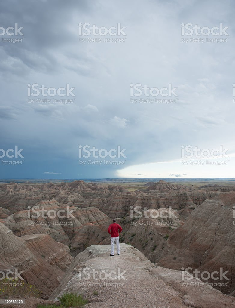 Man Looking at Badlands in South Dakota stock photo