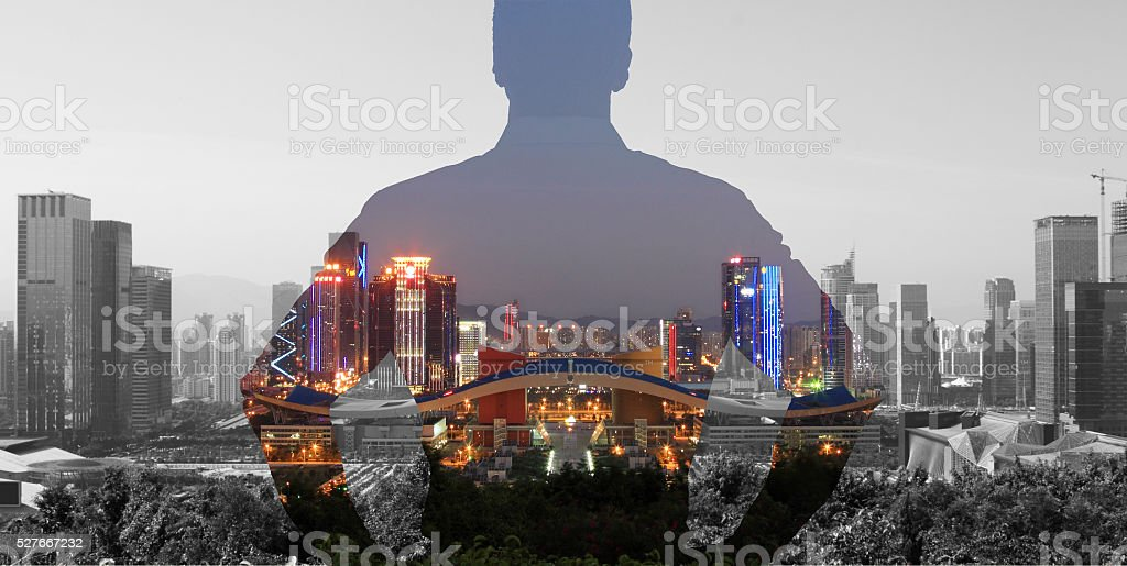 man looking at city view thinking stock photo