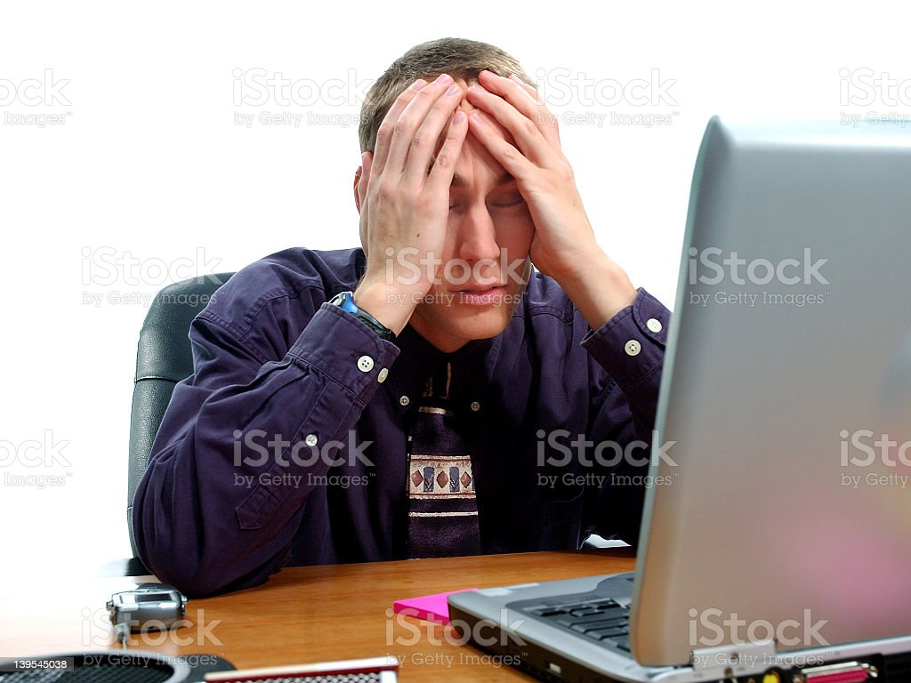 Man looking at computer stressed out about business royalty-free stock photo