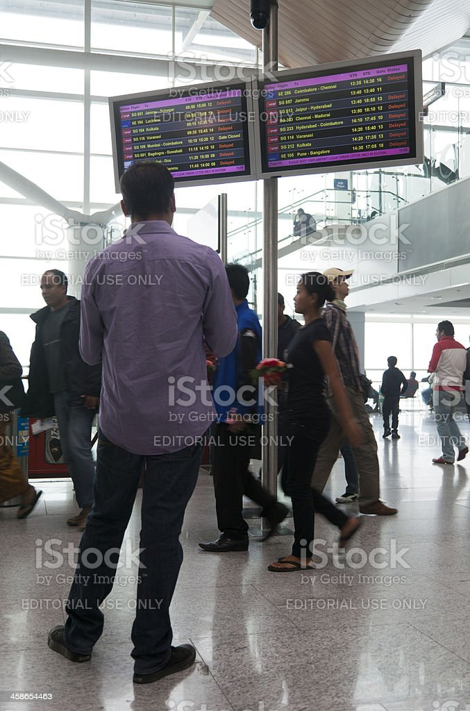 Man looking at departure board royalty-free stock photo