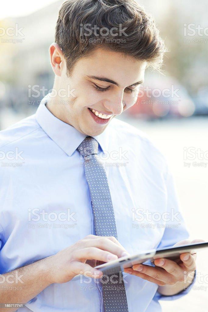 Man looking at digital tablet royalty-free stock photo