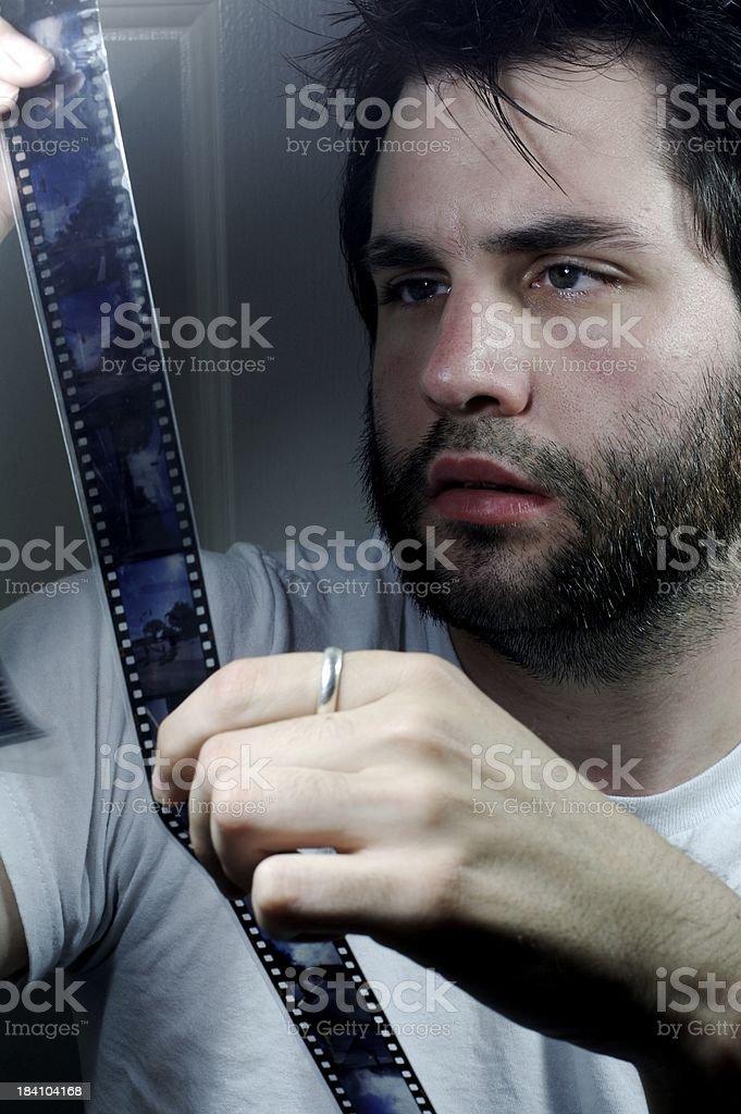 Man looking at filmstrip royalty-free stock photo