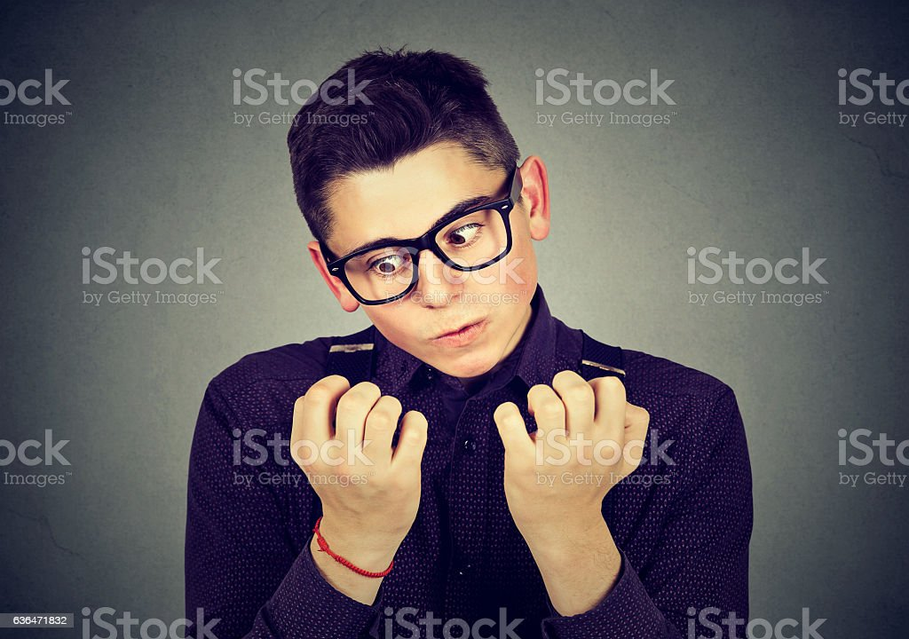 man looking at hands nails obsessing about cleanliness stock photo