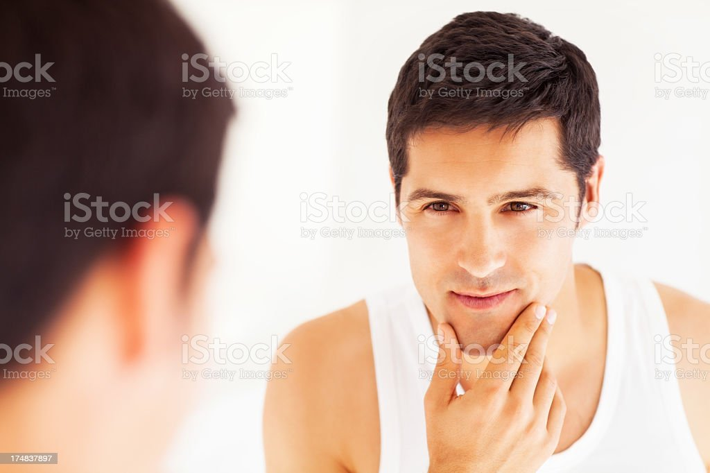 Man Looking At Himself In Mirror stock photo