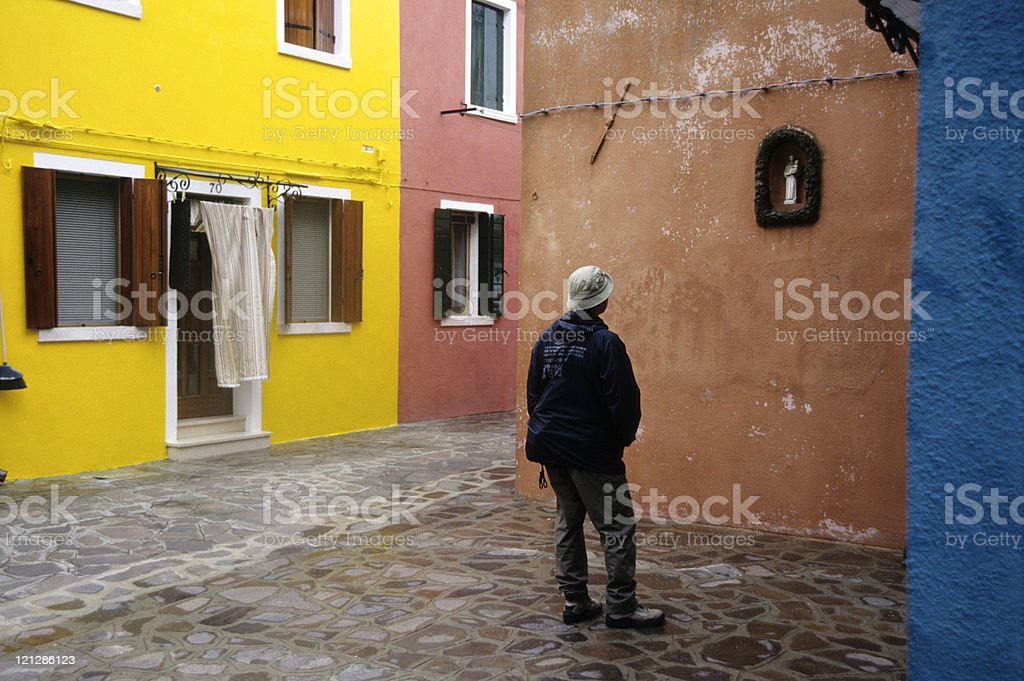Man looking at Jesus Christ statue on wall, Italy, Venice royalty-free stock photo