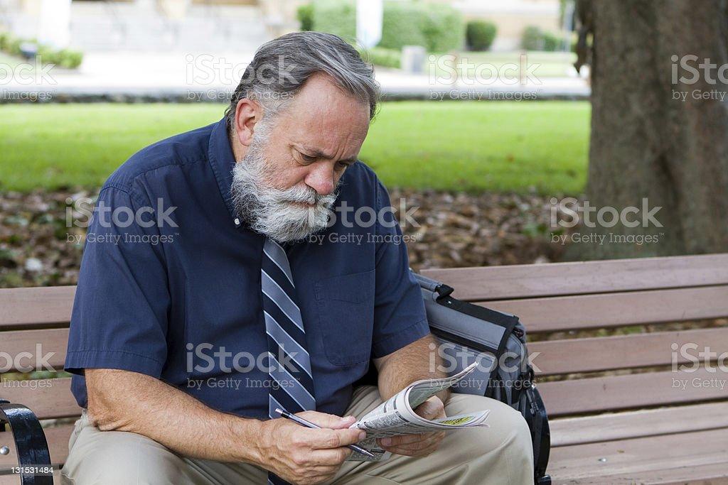 Man Looking At Job Ads stock photo