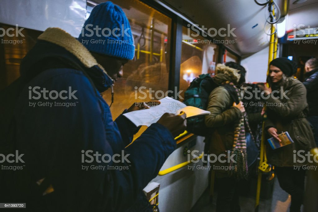 Man Looking At Locating Map In Metro stock photo