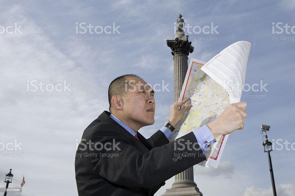 Man looking at map stock photo