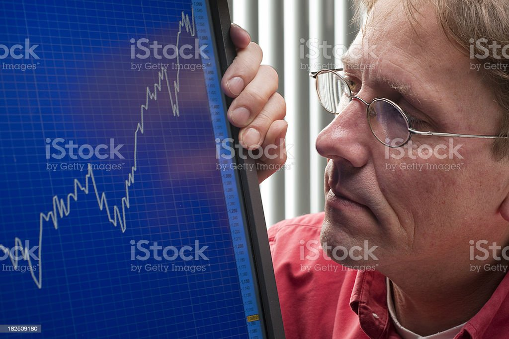 man looking at monitor showing exchange rate chart XXXL stock photo