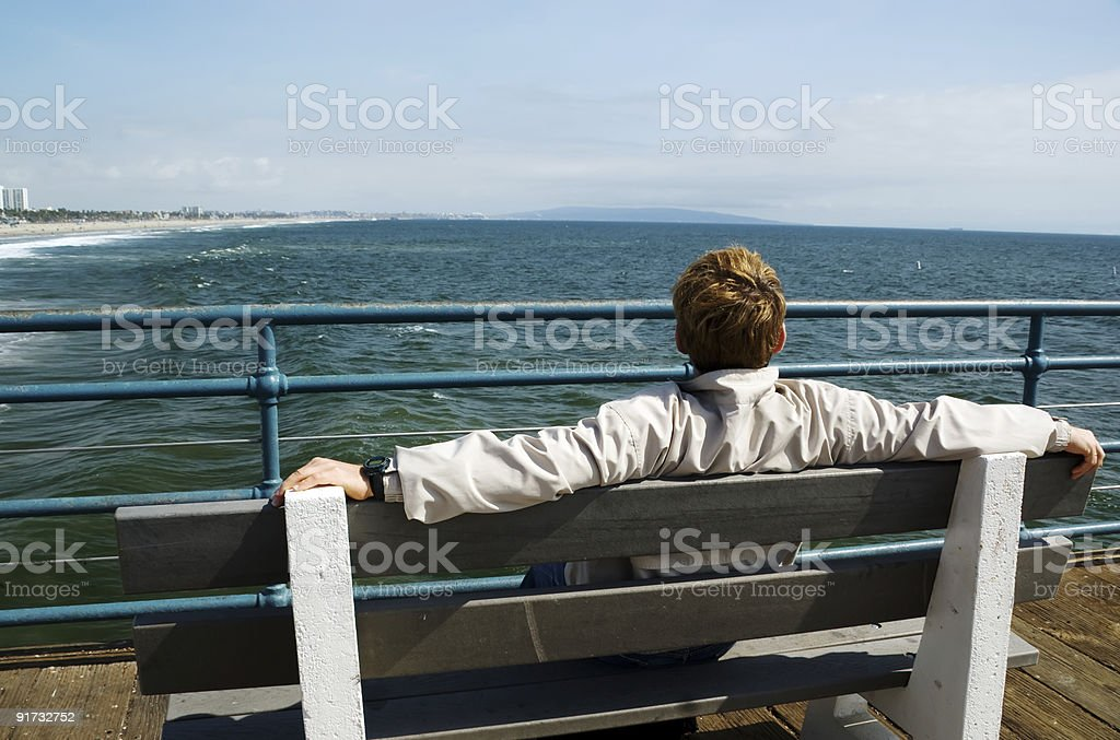 Man looking at ocean stock photo