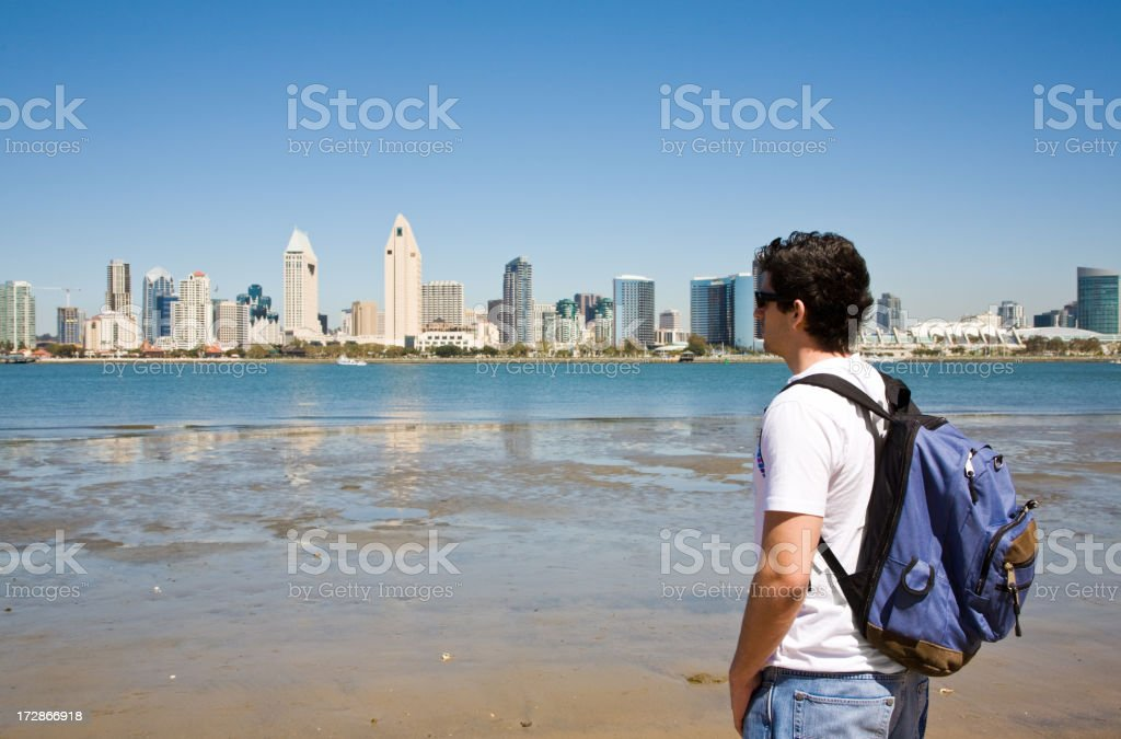 A man looking at San Diego, California from the shore.  royalty-free stock photo