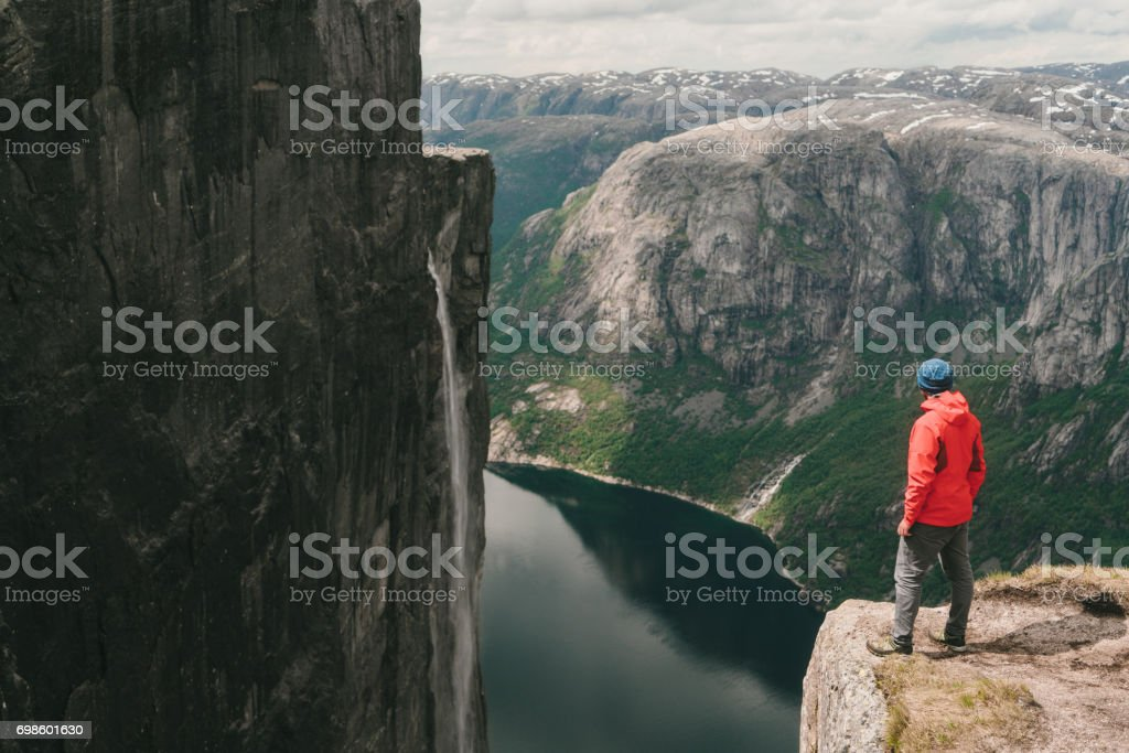 Man  looking at scenic view of Lysefjorden from Kjerag mountain stock photo