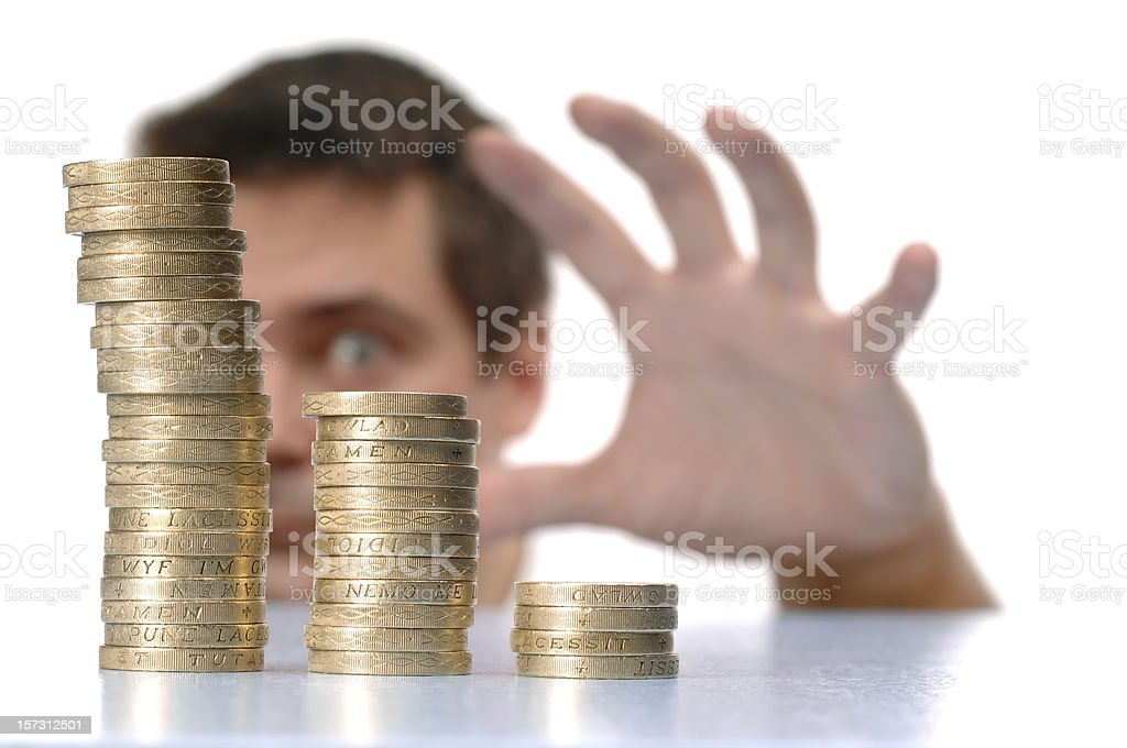 Man looking at stack of coins royalty-free stock photo