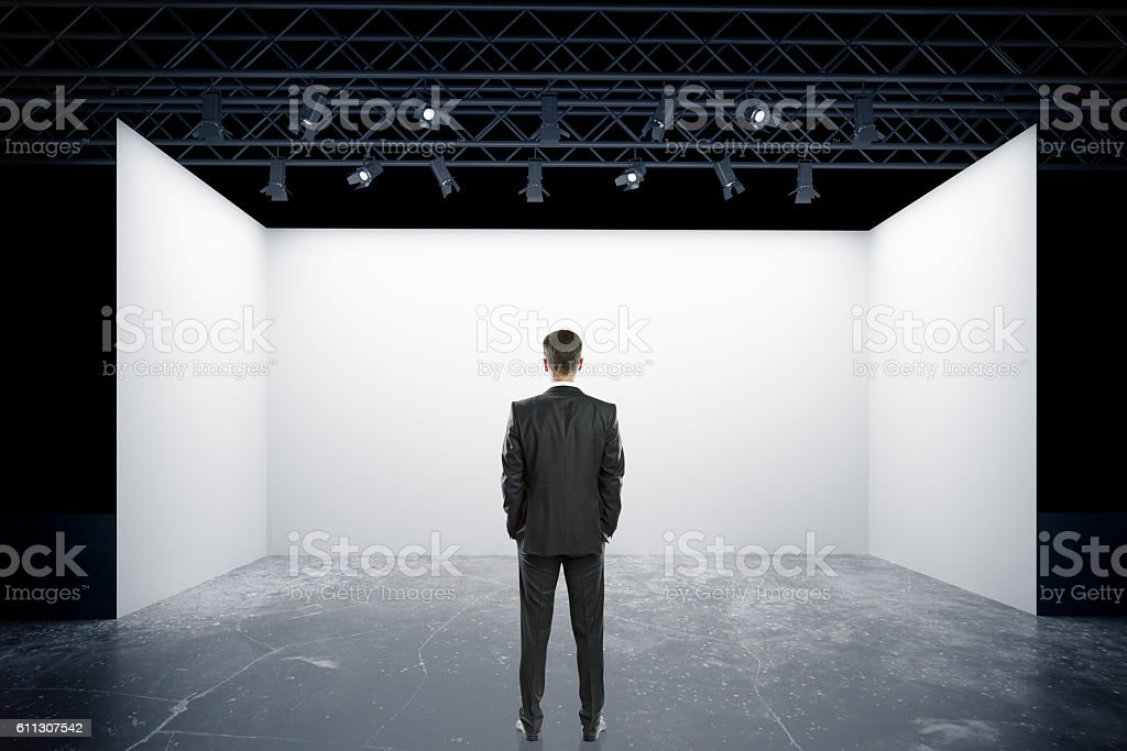 Man looking at stage stock photo