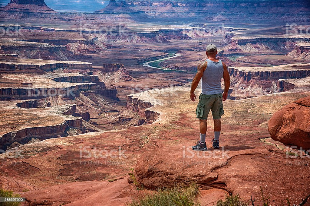 Man Looking at the Awesome View of Canyonlands National Park stock photo