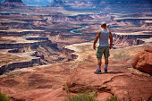 Man Looking at the Awesome View of Canyonlands National Park