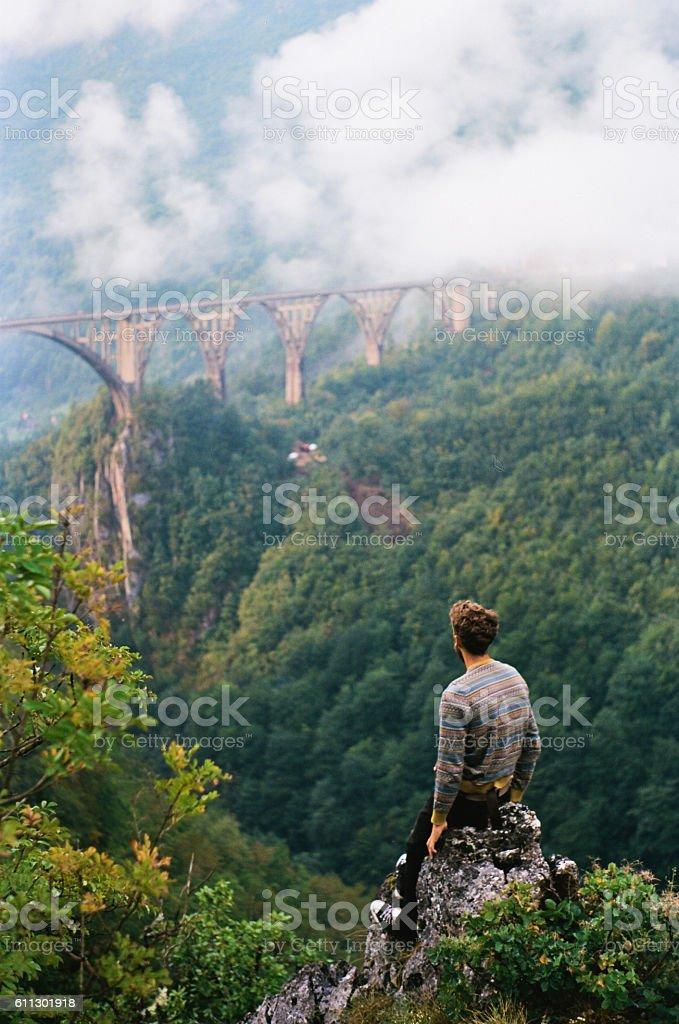 Man looking at the bridge on Tara river stock photo