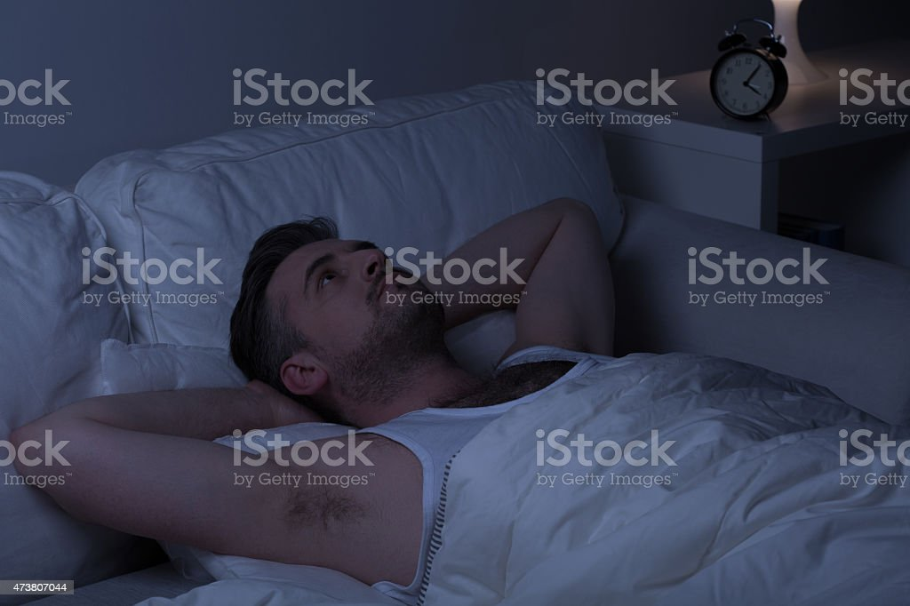 Man looking at the ceiling stock photo